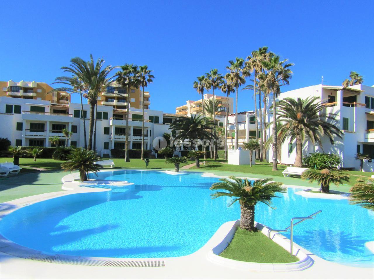 Location Appartement à Xeraco. Alquiler anual. residencial privado con piscina y primera linea