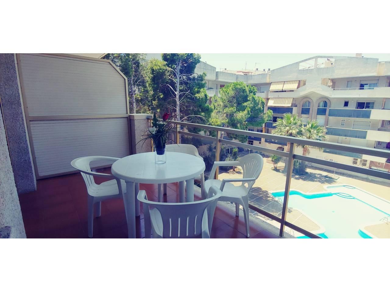 Location saisonnière Appartement  Calle barbastre, 16. Apartamento con terraza y piscina. el apartamento consta de una