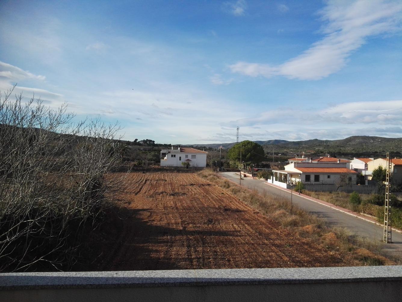 Chalet adosado en Calle Alcala