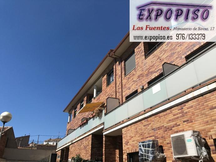 Foto 1 de Casa adosada en Muel Adosado Seminuevo Financiado 100% / Muel